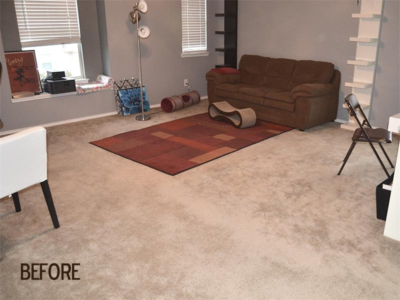 Before picture of family sitting room with previous carpeting.