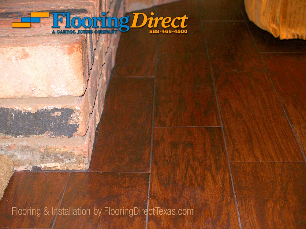 Wood look tile installation cut under fireplace brick by for Direct flooring