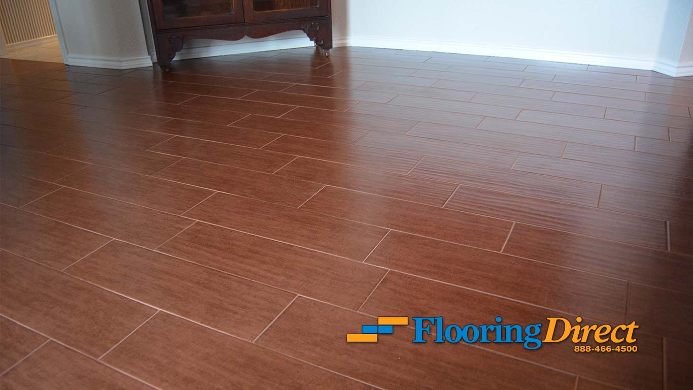 Wood look tile flooring installation pictures in for Tile floor installation